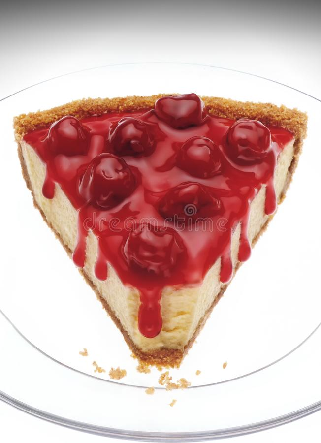 Closeup of cherry cheesecake still life on clear glass dish stock photo