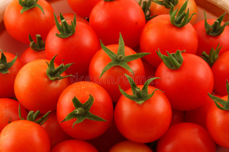 Closeup Of Cherry Tomatoes With Green Stems Stock Photos