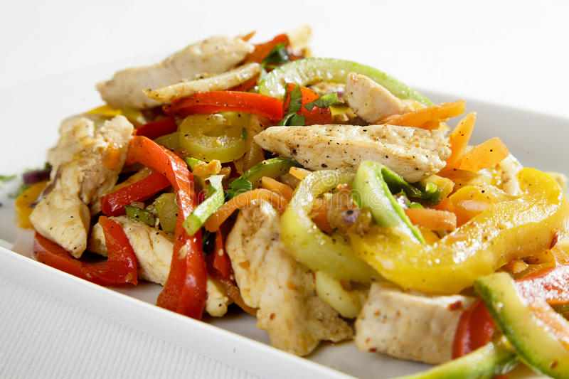Closeup of chicken with vegetables. Close up of italian chicken with coloured vegetables and selective focus royalty free stock photography