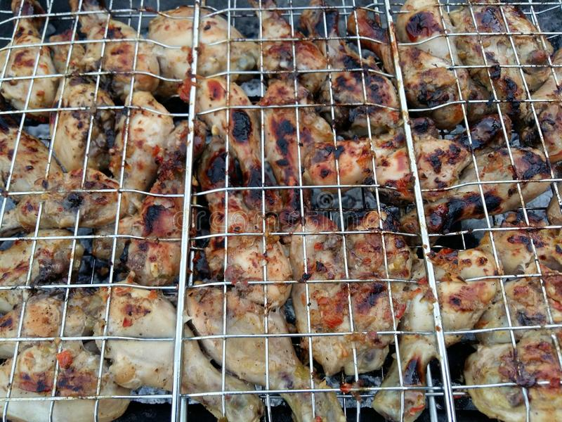 Closeup of Chicken wings and kebabs and on BBQ royalty free stock photo