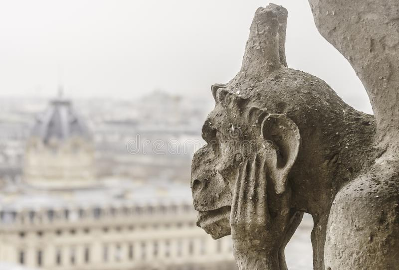 Closeup of a chimera of the Notre-Dame of Paris cathedral Franc stock image