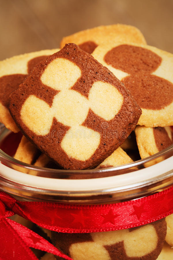 Closeup of christmas cookies in a jar. Closeup of a lot of christmas cookies in a jar in warm light stock photo