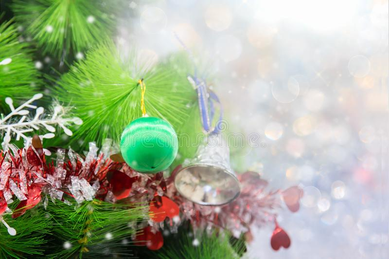 Closeup of Christmas tree with light, snow flake. Christmas and New Year holiday background. vintage color tone stock images