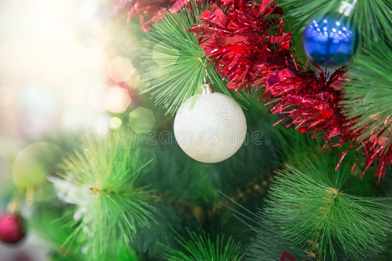 Closeup of Christmas tree with light, snow flake. Christmas and New Year holiday background. vintage color tone. Christmas and New Year holiday background royalty free stock photography