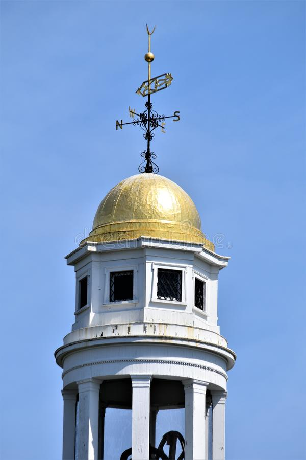 Church steeple with blue sky, Town of Concord, Middlesex County, Massachusetts, United States. Architecture. Closeup of church steeple and blue sky with gold stock photo