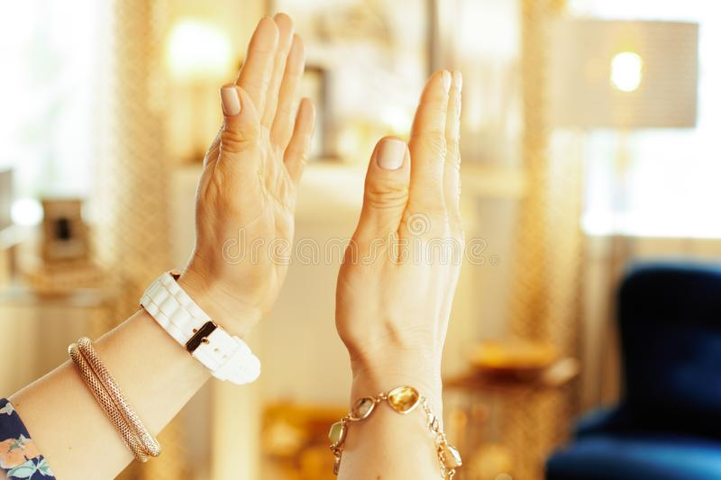 Closeup on clapping hands of modern housewife in house. Closeup on clapping hands of modern housewife in the house royalty free stock photos