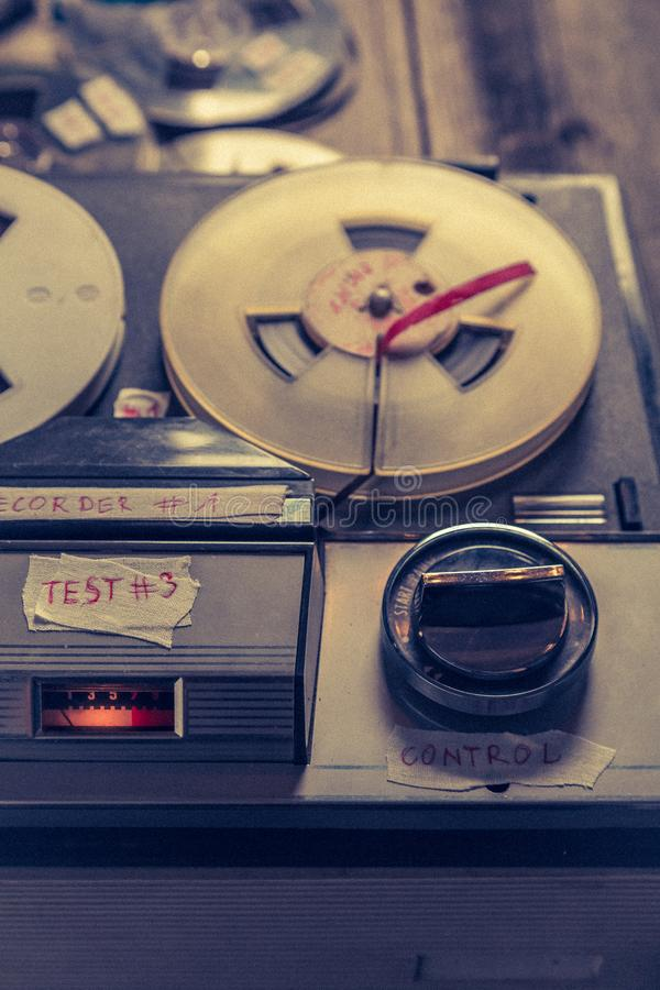 Classic audio tape recorder and roll of tape. Closeup of classic audio tape recorder and roll of tape royalty free stock photo