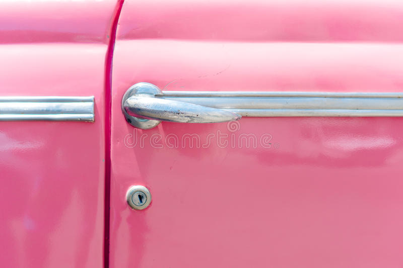 Closeup of classic pink vintage car in Old Havana, Cuba. The most popular transportation for tourists are used as taxis. View of yellow classic vintage car in stock image
