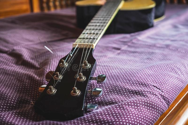 Closeup of classical guitar in low angle royalty free stock photography