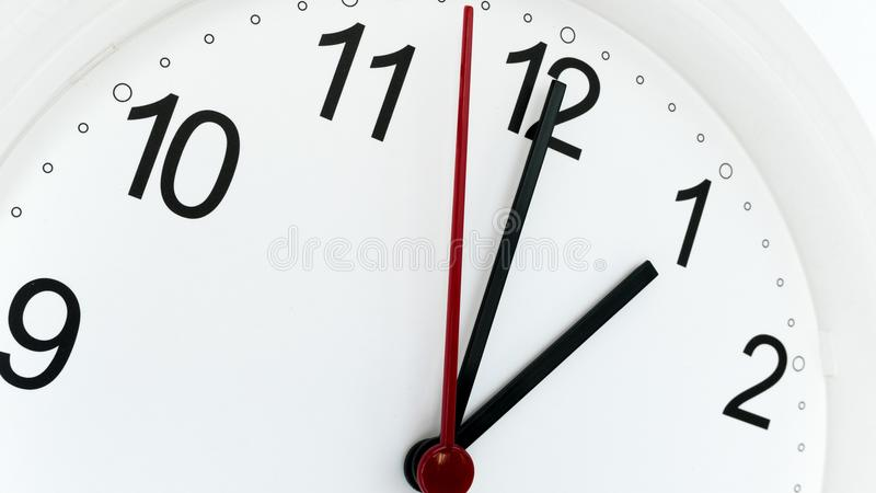 Closeup clock ticking showing one hour royalty free stock photo