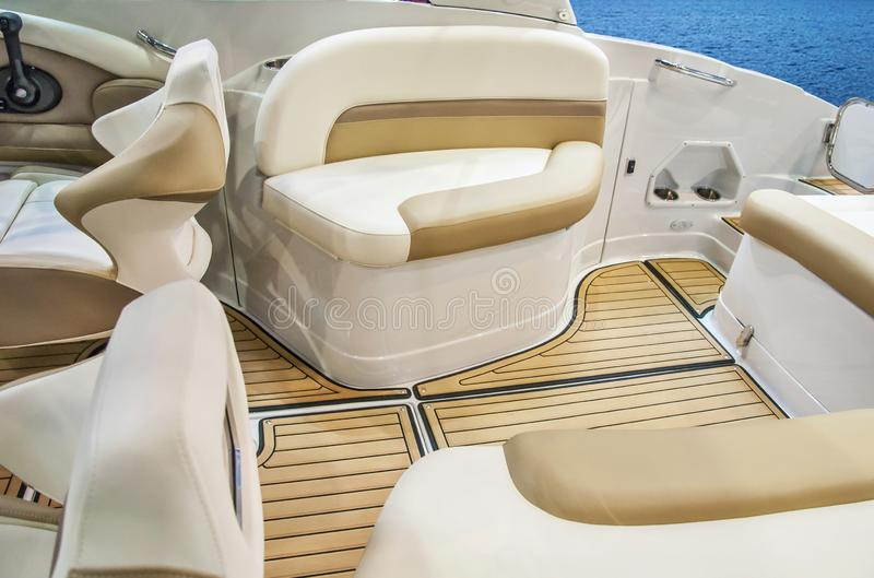 Cockpit of yacht from wood and leather. Closeup of cockpit of luxury yacht. Cockpit of luxury seagoing boat. interior from wood and leather stock photo
