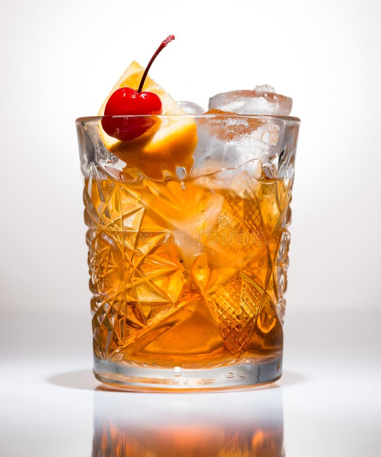 Closeup of Cocktail old fashion. Close-up on a light background royalty free stock image