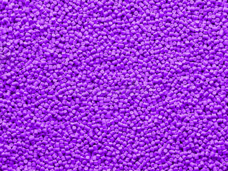 Closeup of colored chalky polymer base. Abstract background. Dye for plastics. Pigment in granules. Polymer balls stock photography