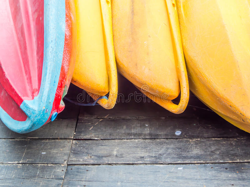 Closeup of colorful canoes on wooden floor royalty free stock photo