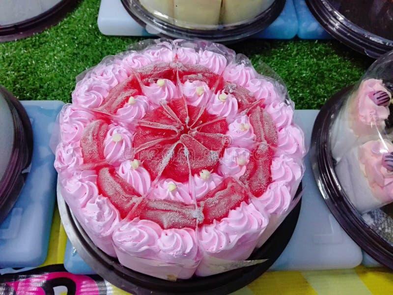 Closeup of colorful cream strawberry cake stock photos