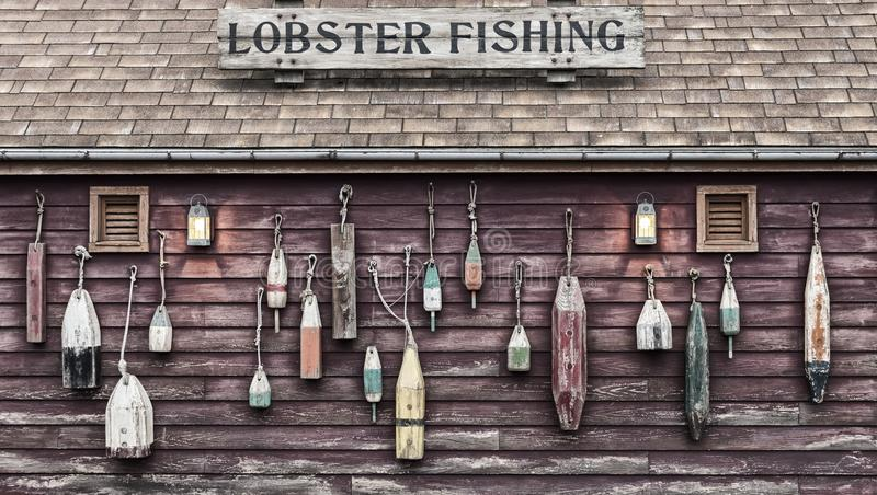 Closeup of colorful floats hanging outside a lobster fisherman`s cottage. stock photography