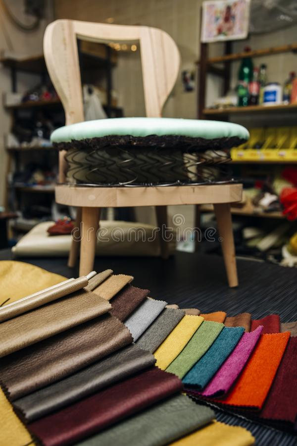 Colorful furniture covers. Closeup of the colorful furniture covers in the upholstery workshop royalty free stock image
