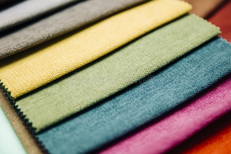 Colorful furniture covers. Closeup of the colorful furniture covers in the upholstery workshop royalty free stock images