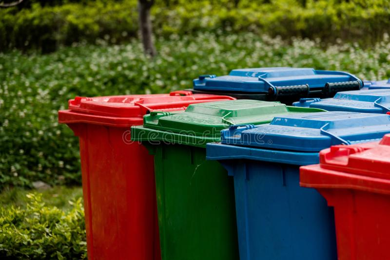 Closeup of colorful garbage cans. In early summer woods stock photo