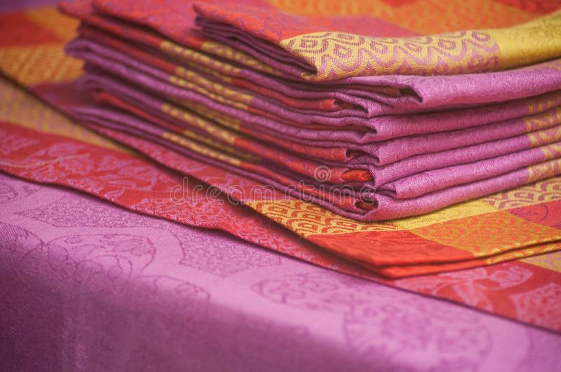 Colorful napkins collection in a decoration store showroom. Closeup of colorful napkins collection in a decoration store showroom royalty free stock photo