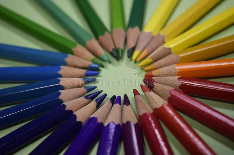 Closeup colorful pencil on green paper background stock photos