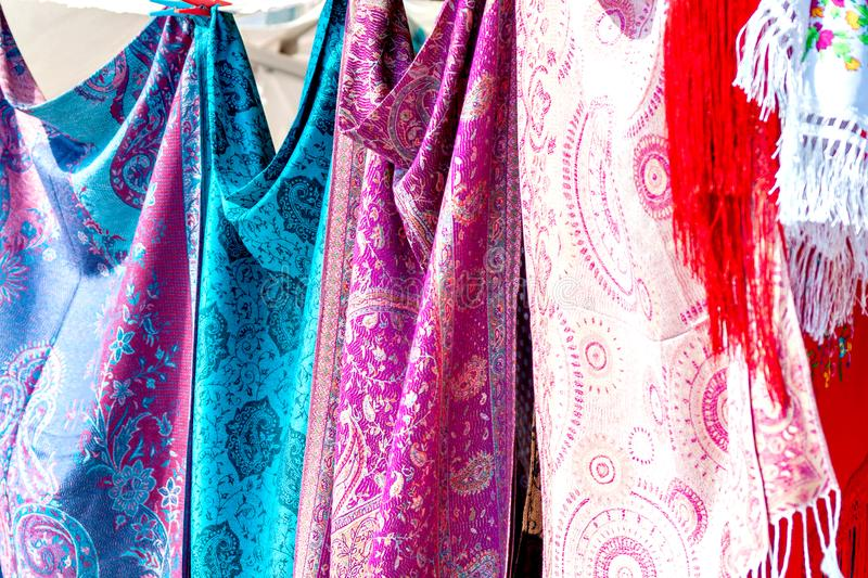 Closeup of colorful Portuguese fabrics and shawls in turquoise, pink and purple colors royalty free stock photography