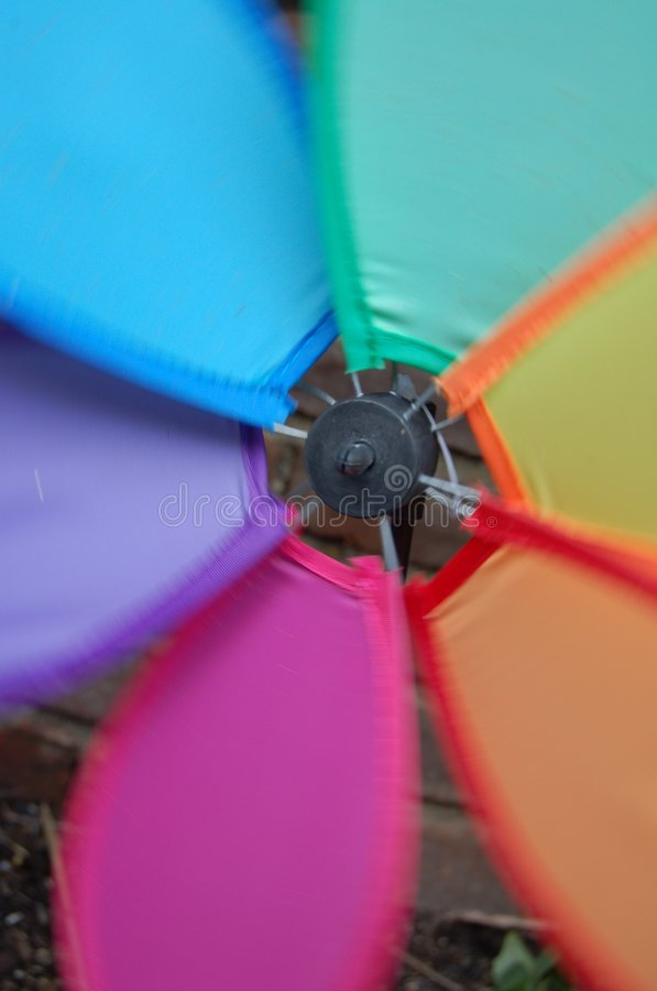 Closeup of Colorful Rainbow Pinwheel Spinning. In motion (Red/Pink, Orange, Yellow, Green, Blue, Purple stock images
