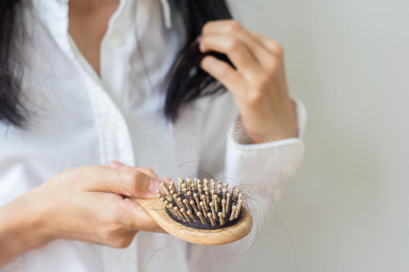 Closeup of comb brush with long loss hair .Woman loosing hair for head healthcare problem with copy space. royalty free stock photos