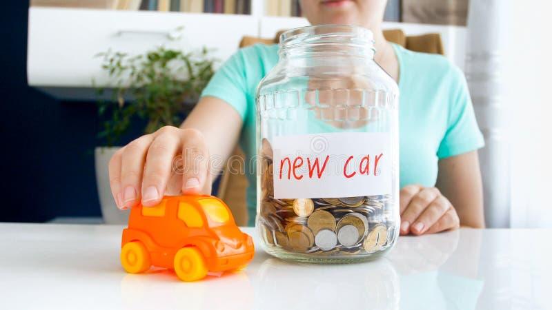 Closeup conceptual photo of saving money for buying new car royalty free stock image