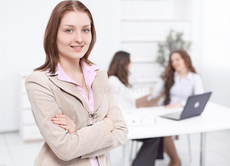 Closeup.confident business woman on the background of the office royalty free stock photography