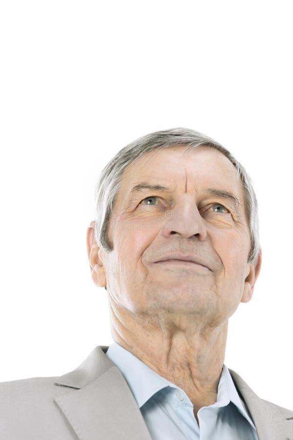 Closeup.confident senior businessman looking up at copy space stock images