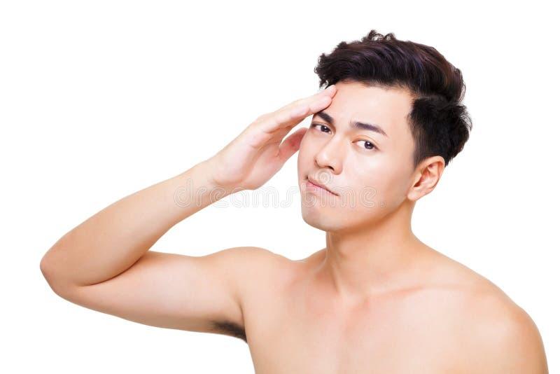 Closeup confuse young man face. Closeup confuse asian young man face stock photography