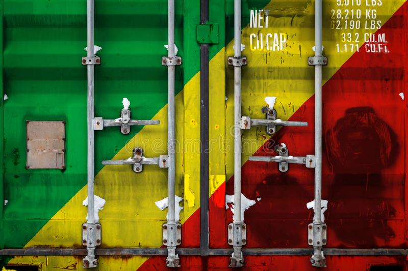 The concept of export-import and national delivery of goods. A closeup of a container with the national flag of the Republic of the Congo. The concept of export stock illustration