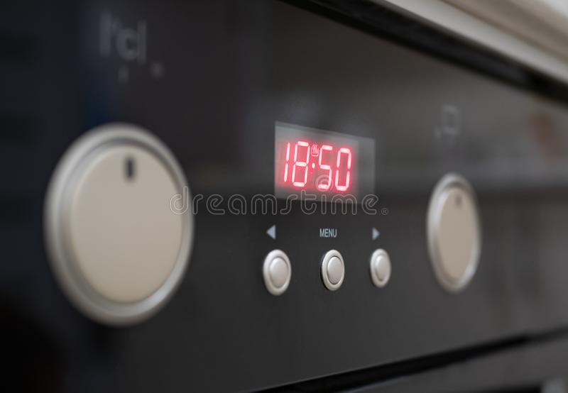 Closeup of control button of kitchen oven stock photography