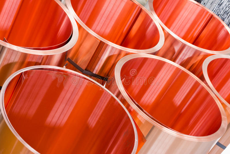 Closeup of copper sheet in rolls. Closeup of red copper sheet in rolls royalty free stock images