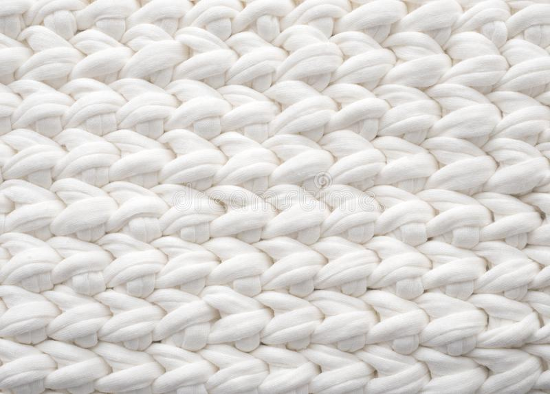 Closeup cotton white knit blanket, warm and comfortable atmosphere. Knit background. Closeup cotton white knit blanket, warm and comfortable atmosphere. Knit royalty free stock photos