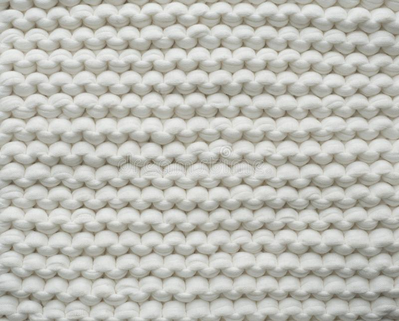 Closeup cotton white knit blanket, warm and comfortable atmosphere. Knit background. Closeup cotton white knit blanket, warm and comfortable atmosphere. Knit stock image