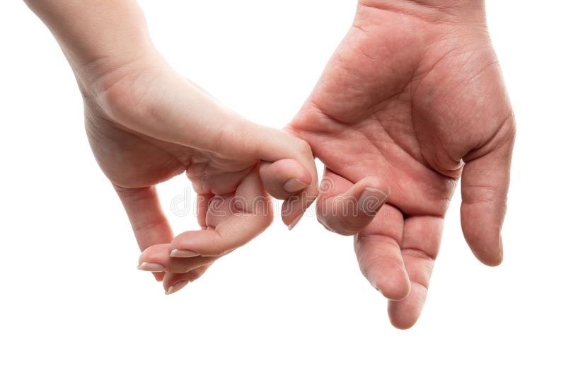 Closeup of couple holding fingers royalty free stock photos