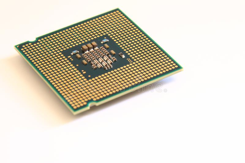 Closeup CPU Central Processing Unit or Microchip Computer on white background stock photo