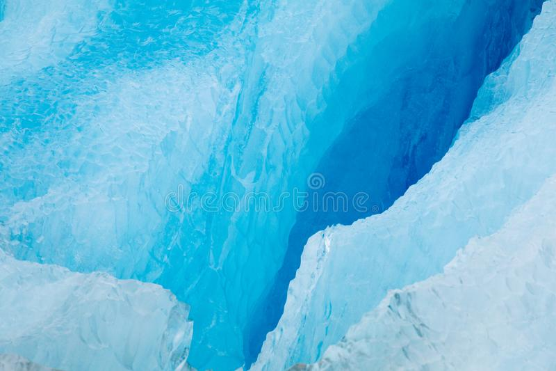 Closeup of Cracked iceberg. Alaskan sea and ocean cruise with icebergs and glaciers blue melting shrinking global warming climate change disappearing stock photos