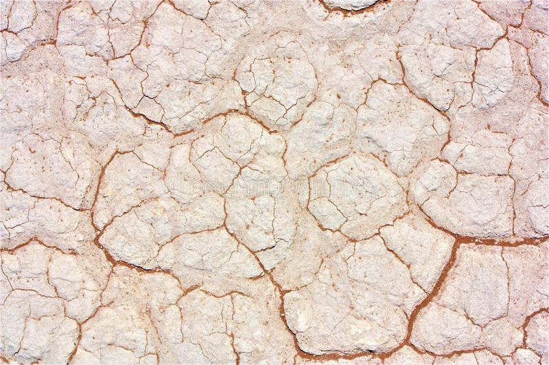Closeup of a cracked white rocky wall stock photography