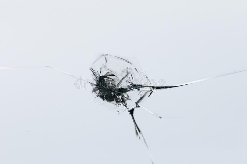 Closeup of cracked windshield with fissure lines, abstract background with copy space royalty free stock photo
