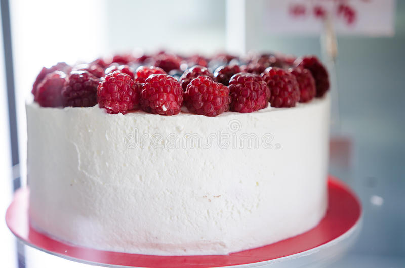 Closeup of cream and raspberry cake royalty free stock images