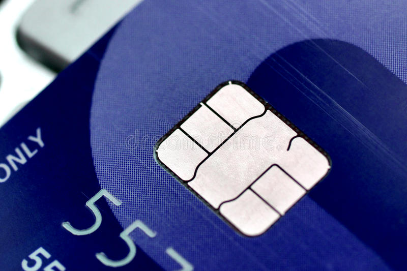 A closeup of credit card chip. / Measure to deal with counterfeit card fraud / Credit card security and data encryption stock photos