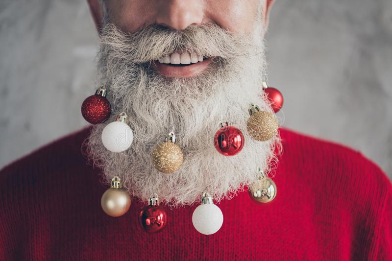 Closeup cropped photo concept of old positive santa claus man colorful toy balls in long beard x-mas decorations wear. Closeup cropped photo concept of old stock image