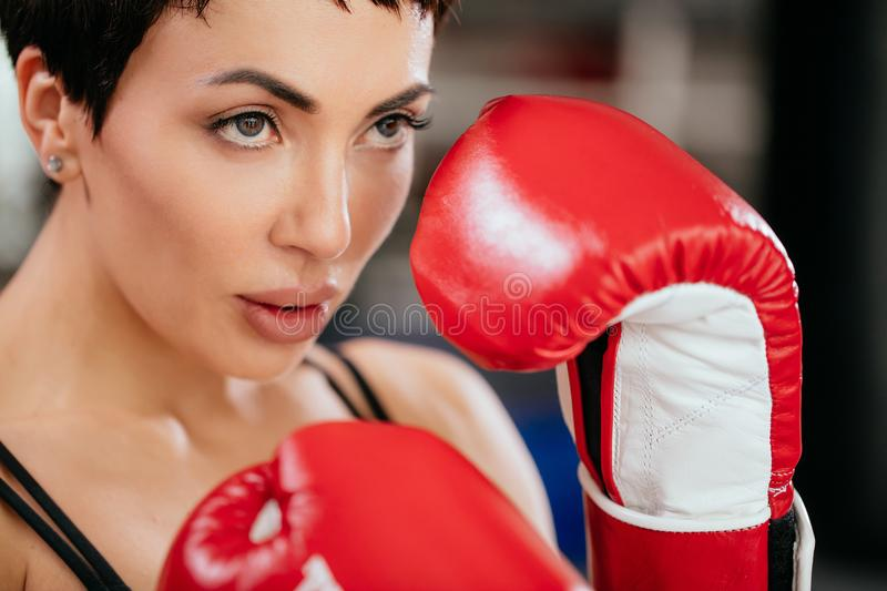 Closeup cropped photo of woman going in for kickboxing stock photo