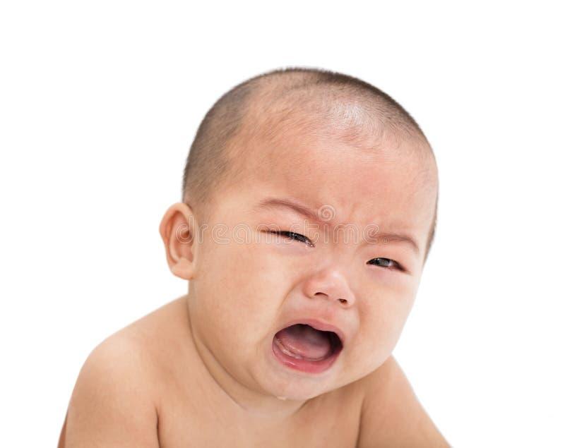 Closeup crying asian baby stock images