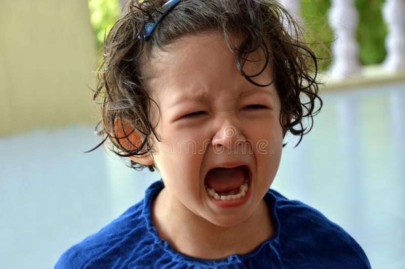 Closeup of a crying little toddler girl. stock images