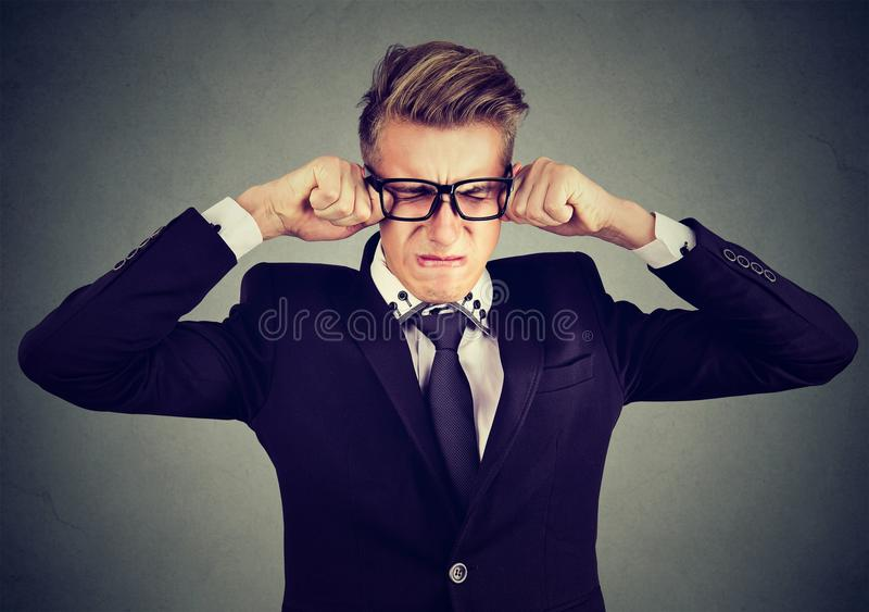 Closeup of a crying man in glasses stock image
