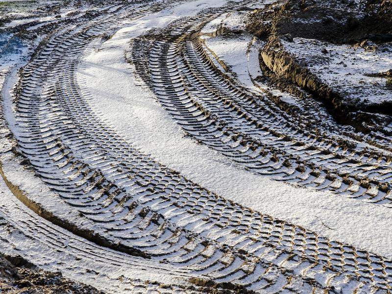 Closeup of curved tire tracks in the mud royalty free stock images